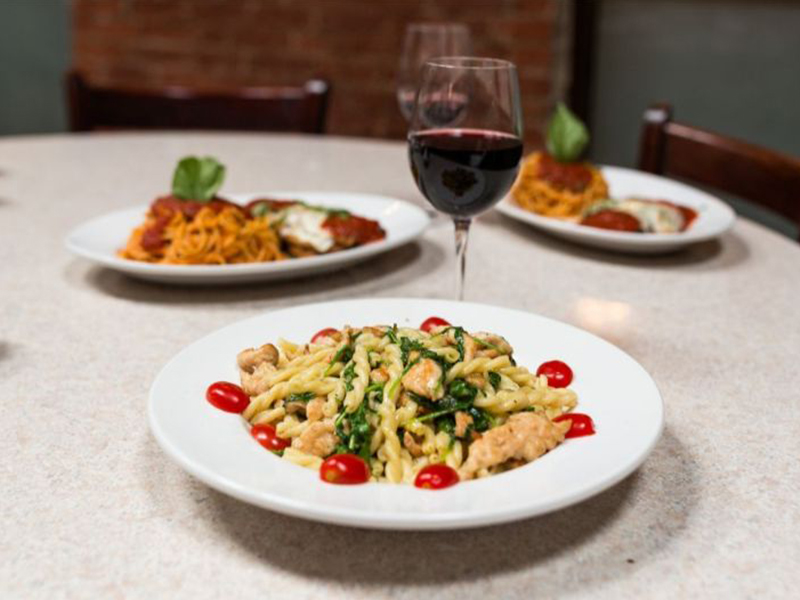 3 pasta dishes and a glass of wine
