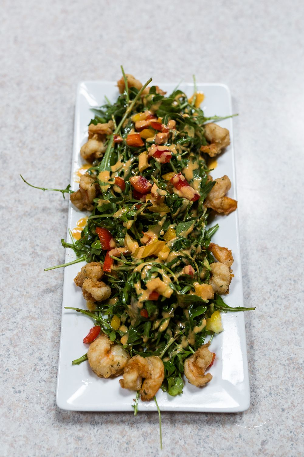 platter with spinach, chicken, and vegatables