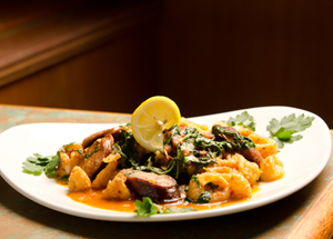 Spicy Calamari with Sausage and spinach.